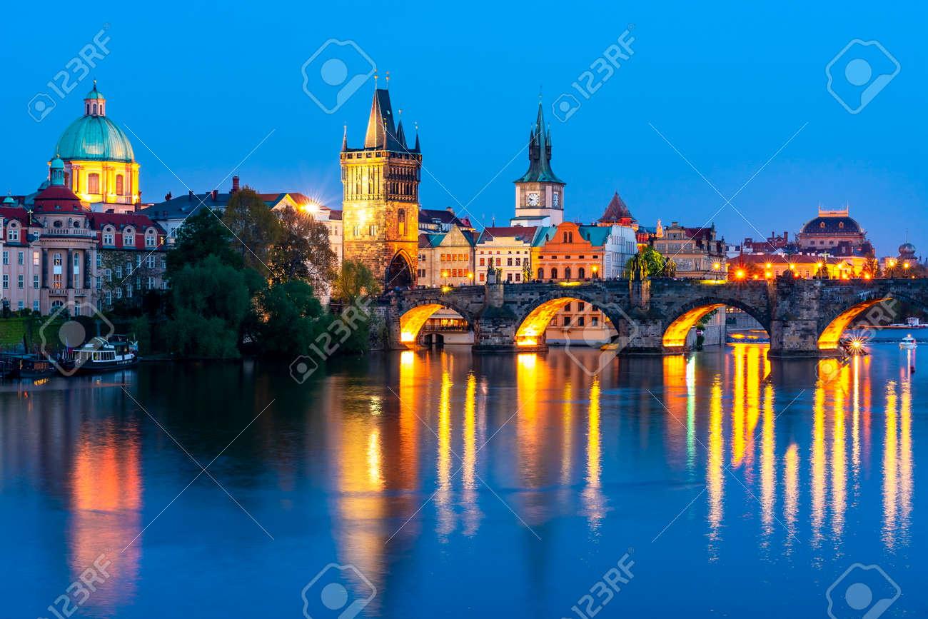 Prague architecture and Charles bridge over Vltava river at night, Czech Republic - 149899693