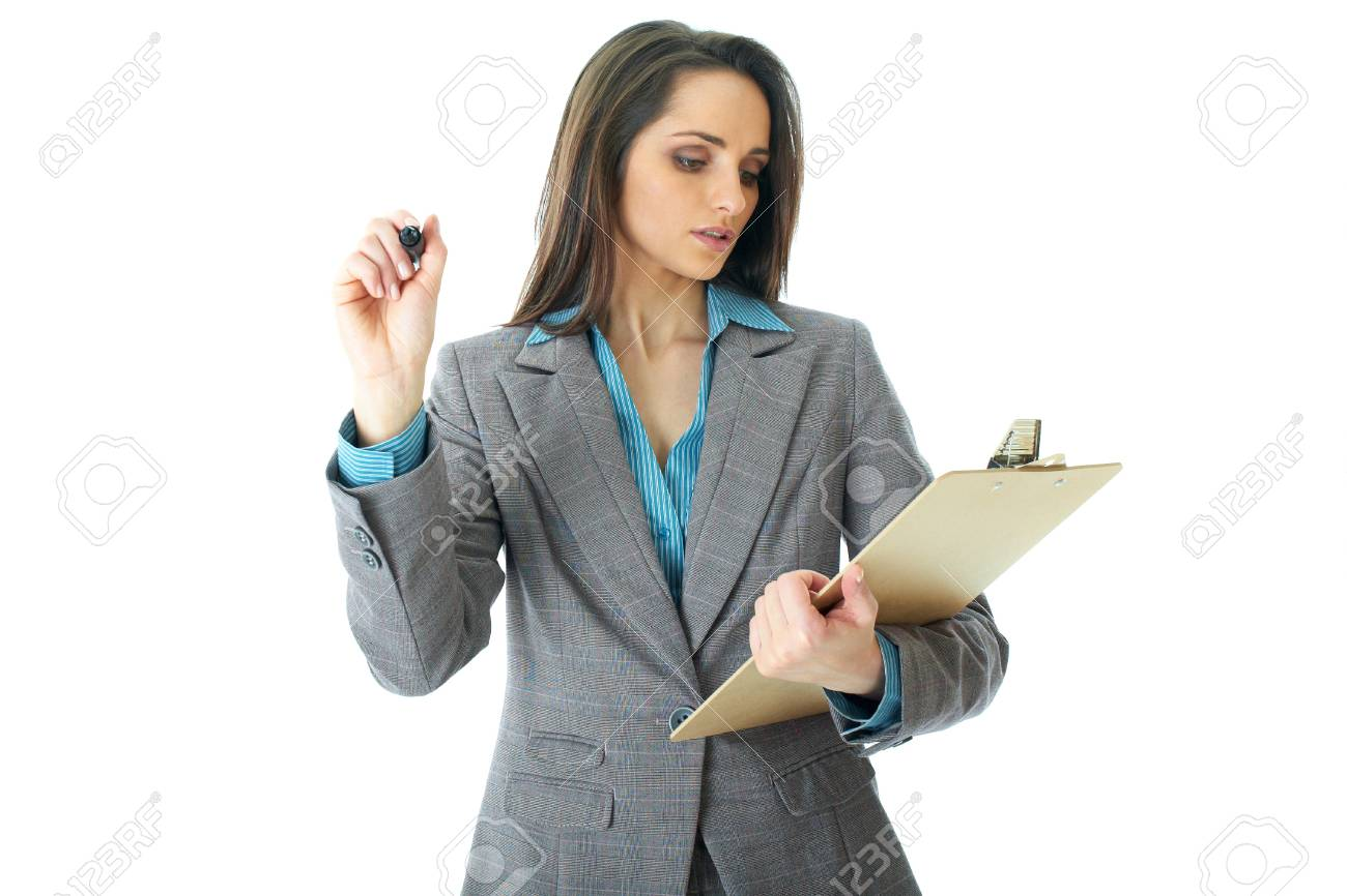 young attractive businesswoman draw in front of her while checking something in her notes, isolated on white background Stock Photo - 11477736