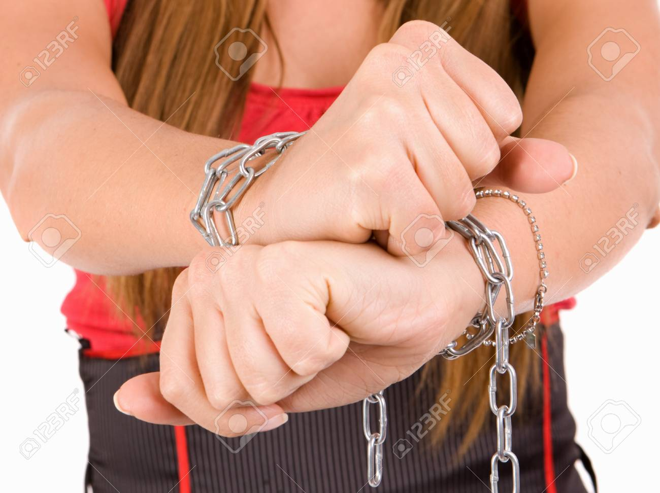 Woman trafficking concept by hands chaind. Stock Photo - 3985851