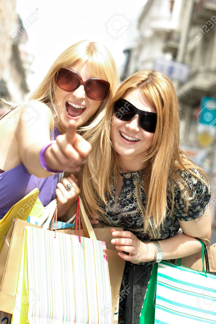 Happiness shopping woman with bags in street environment. Stock Photo - 4891918