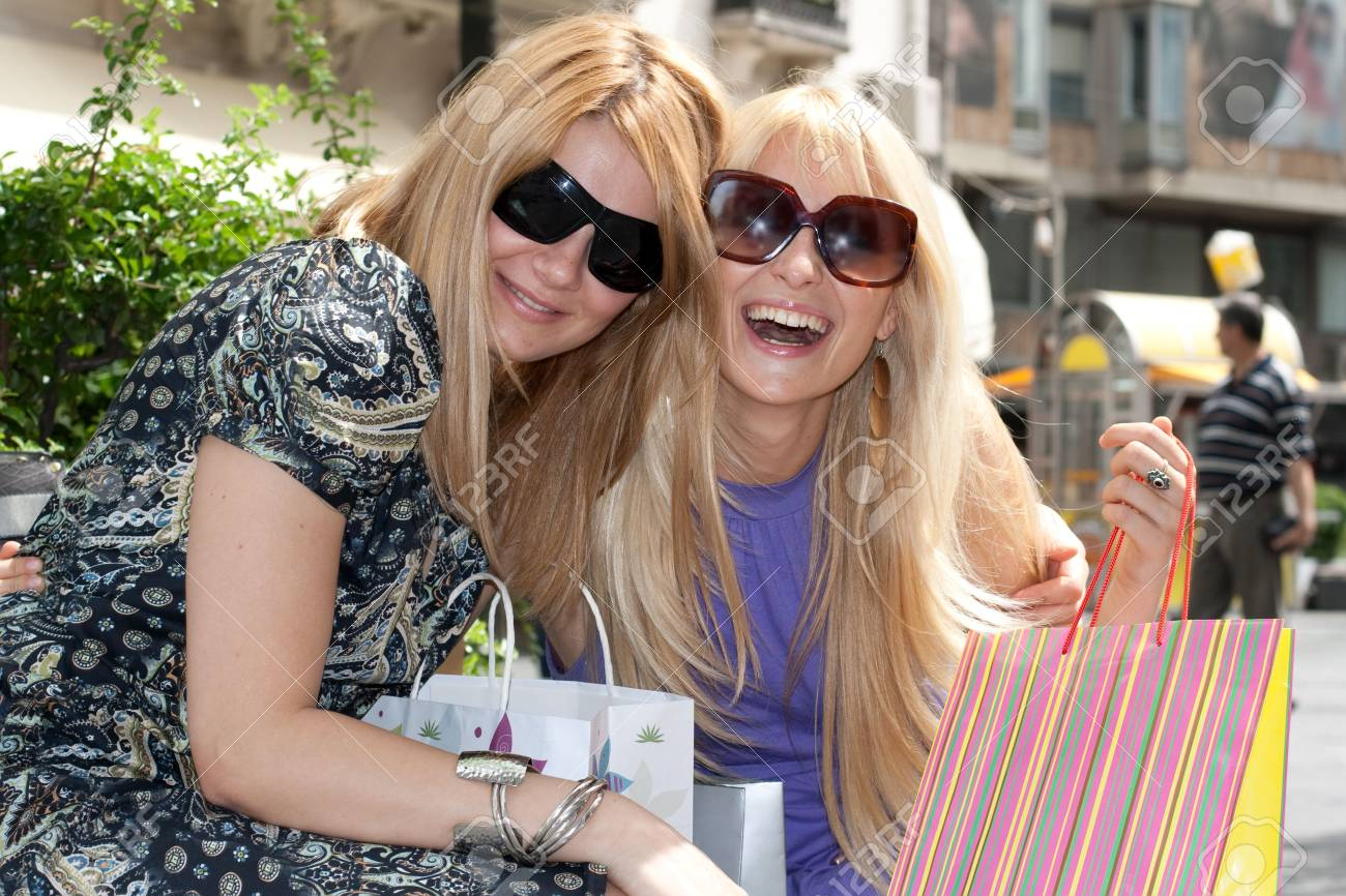 Two happiness shopping womanin the city. Stock Photo - 5434208