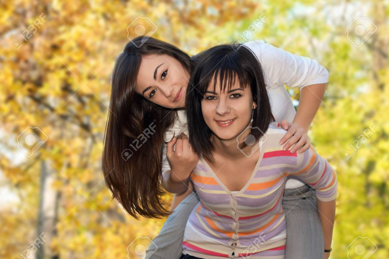 Teenager girls best friends have fun in the park. Stock Photo - 5983263