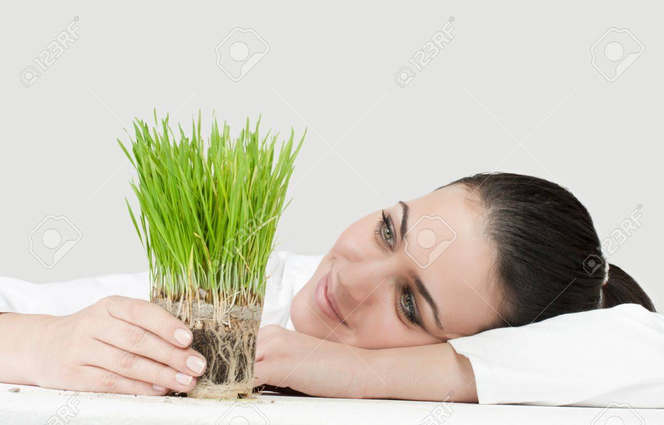 Portrait of businesswoman support green plant. Stock Photo - 8658440