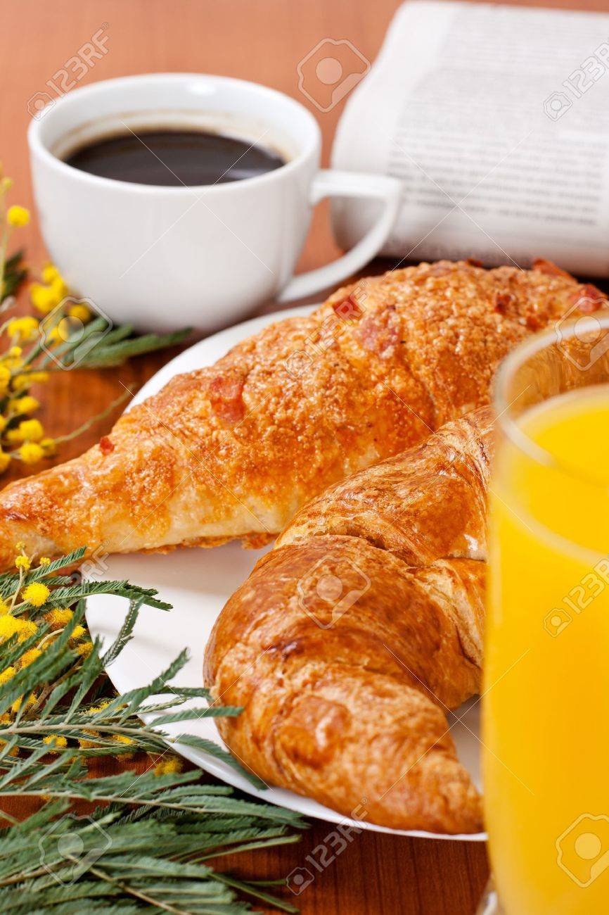 Continental breakfast served with coffee and orange juice. Stock Photo - 8788991