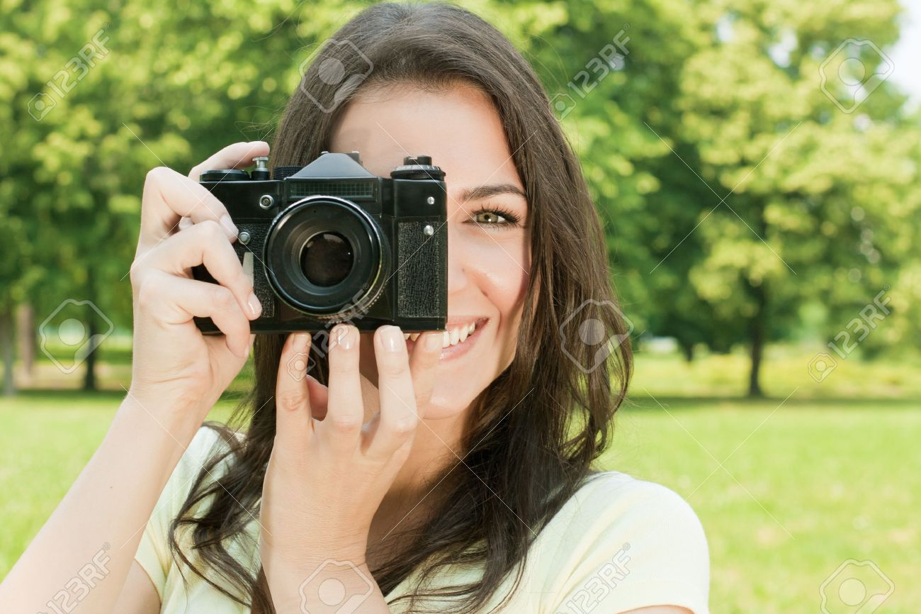 Woman taking photo with old fashioned camera. Stock Photo - 9666925