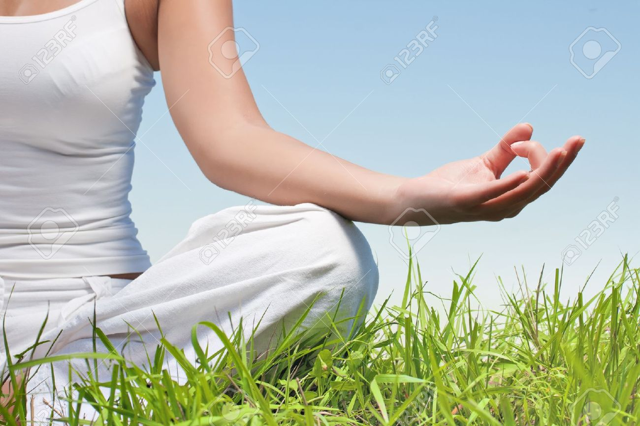 Closeup of woman hands in yoga meditation pose outdoors. Stock Photo - 10411279