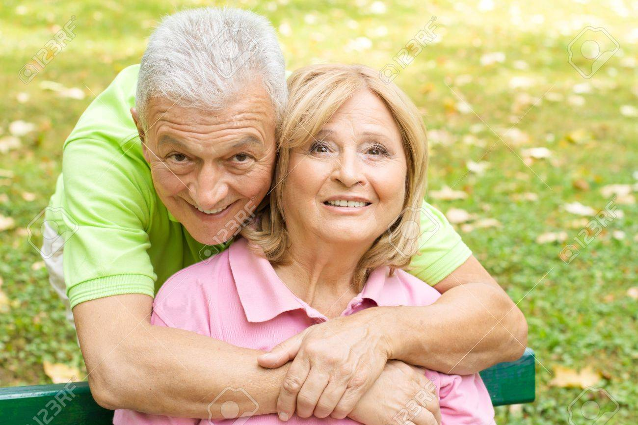 Closeup portrait of happy elderly man embracing mature woman. Stock Photo - 10613037