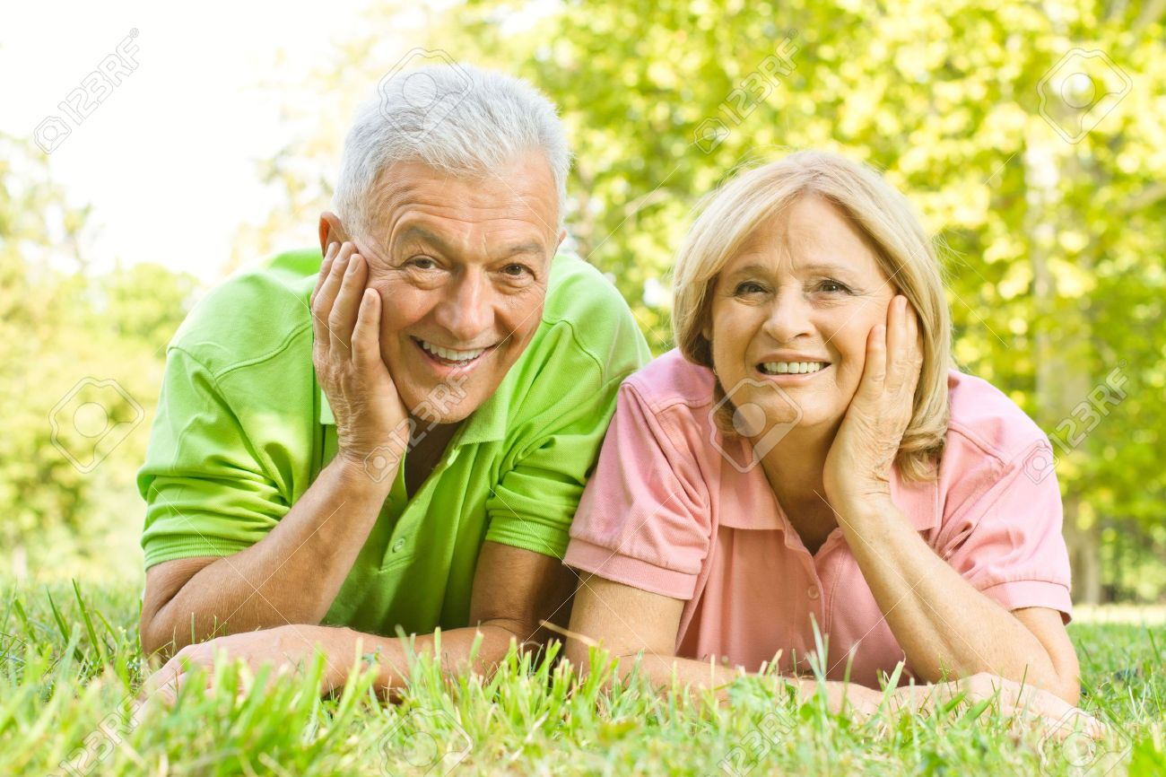 Portrait of happy old people relaxed in nature. - 10760316