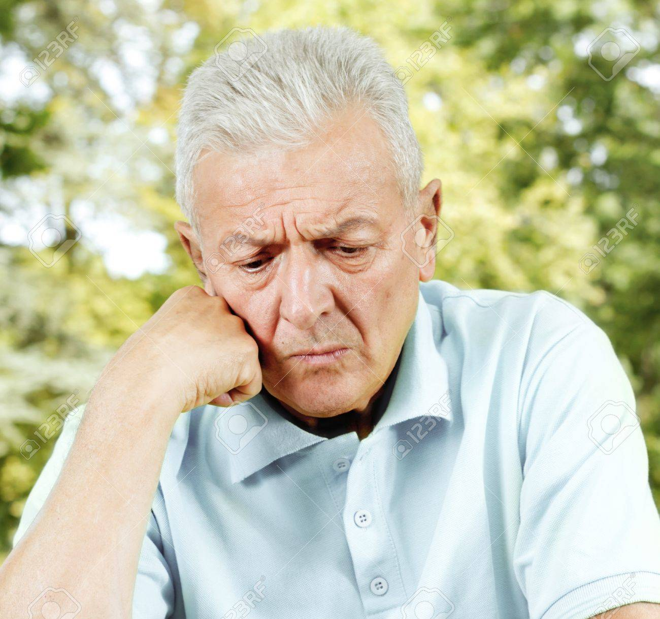Portrait of worried senior man outdoors. - 11212445
