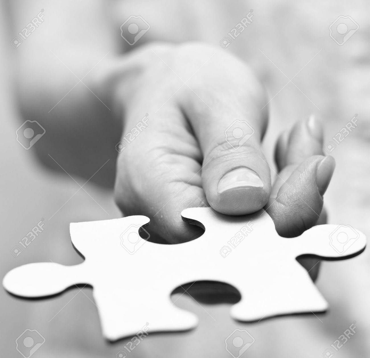 Human hands holding the missing piece - 12893186