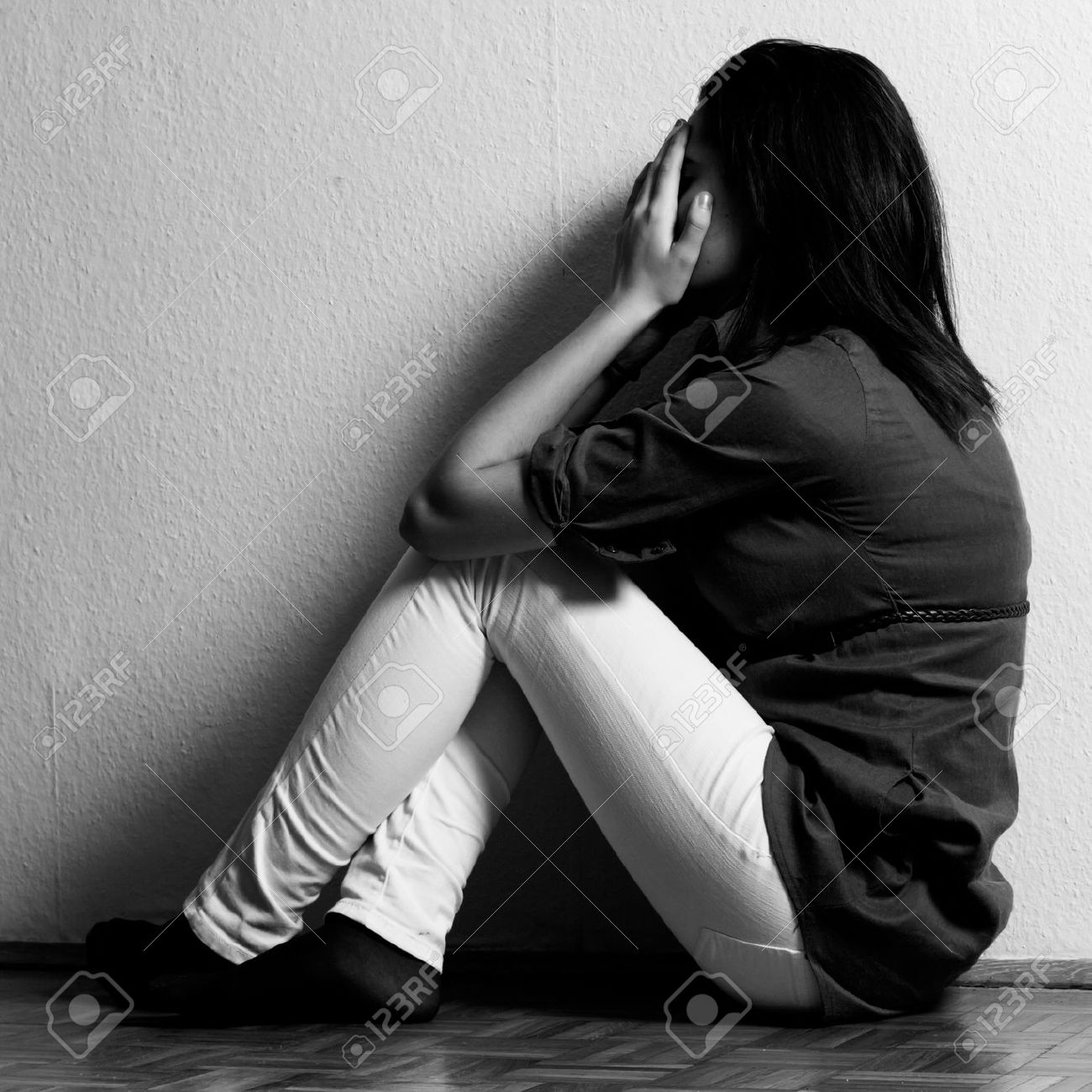 Depressed teenage girl cover the face with her hands. - 18576559