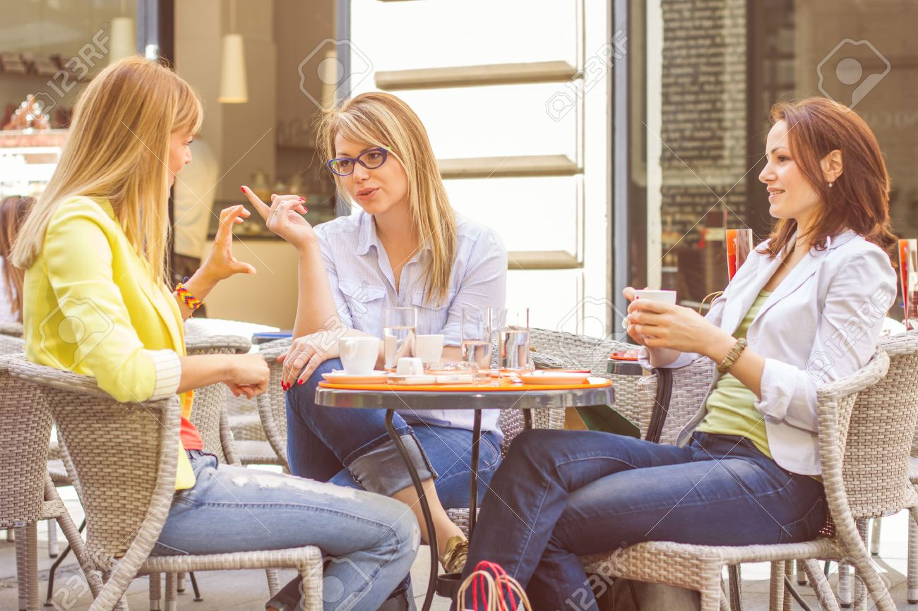 Three Young Women have Coffee Break Together in street cafe. Caucasian female relaxing on beautiful summer day in the city. - 40819650