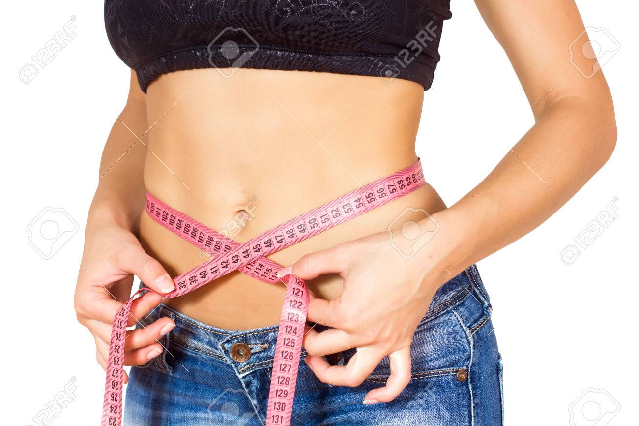 Slim Female with perfect healthy fitness body, measuring her thin waist with a tape measure. Stock Photo - 46977267