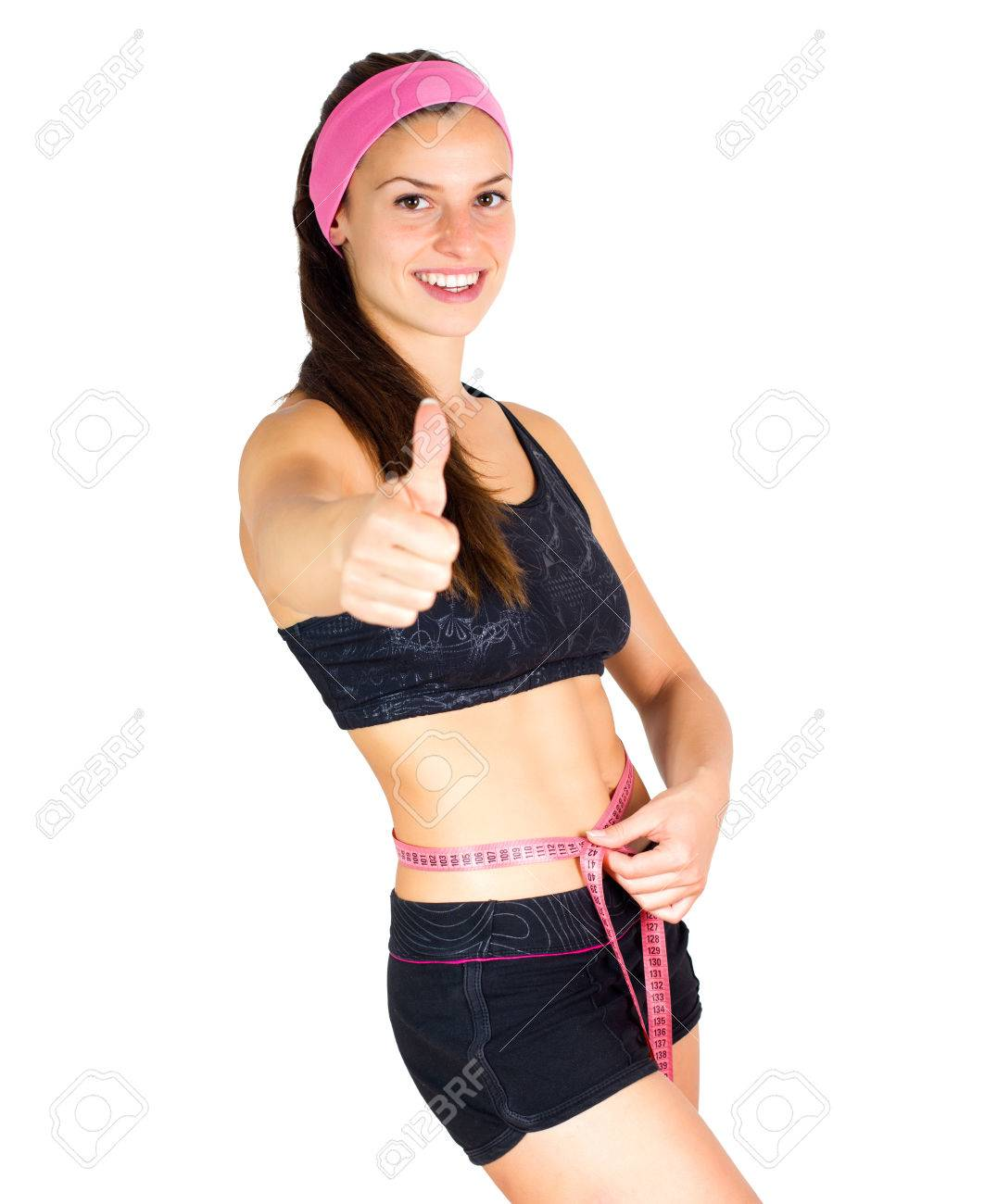 Slim Young Woman with perfect healthy fitness body, measuring her thin waist with a tape measure. - 46977936