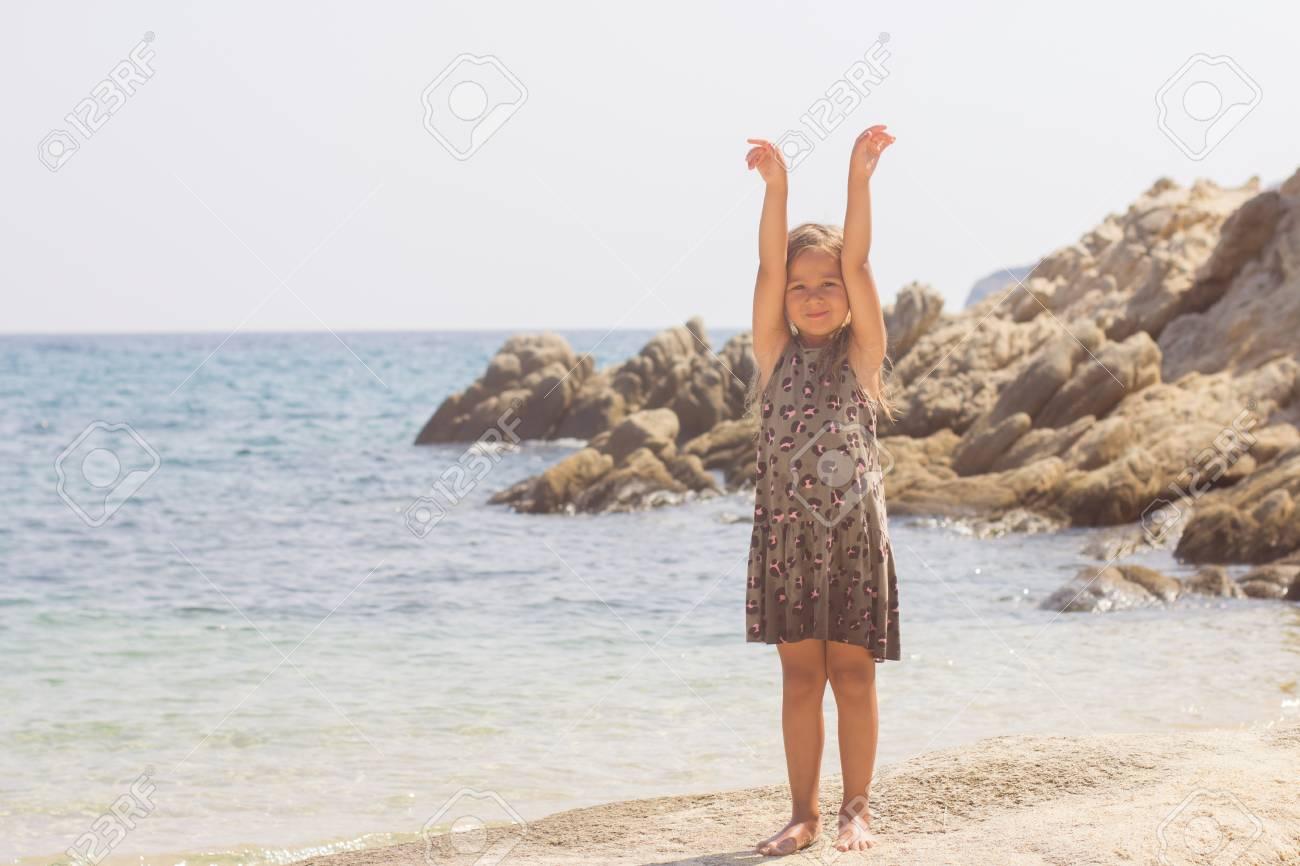Portrait of Little girl on the sandy beach. Summer vacation. - 63460813