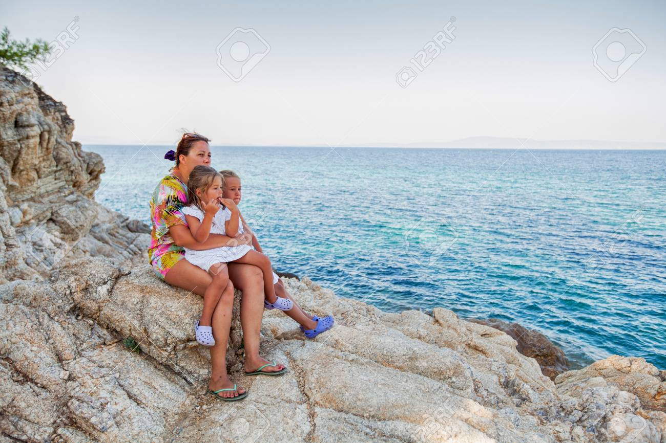 0688defe9d45b Family summer travel vacation, mother with daughters enjoying summer day on  beach. Stock Photo