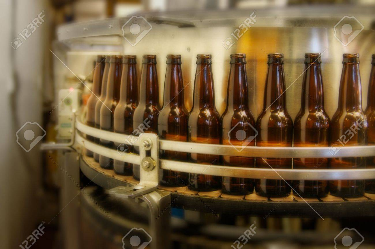 factory bottle filling line getting ready to fill bottles. Stock Photo - 2827565