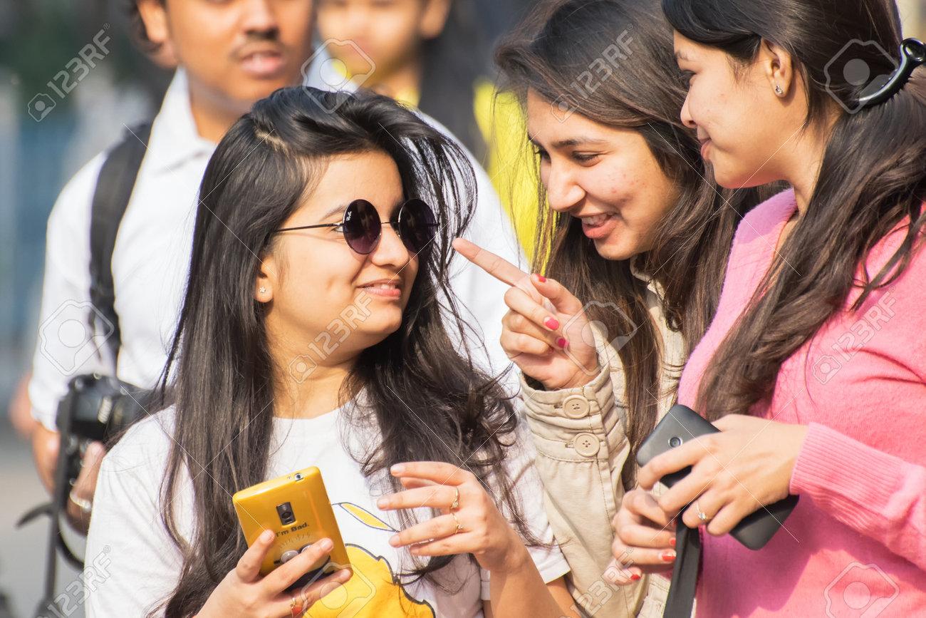 KOLKATA, WEST BENGAL, INDIA - JANUARY 17TH 2016 : Beautiful young girls  teasing each