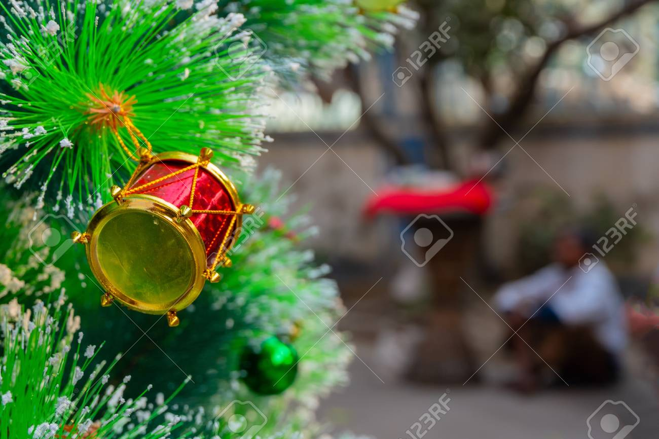 Christmas Tree In India.Merry Christmas Christmas Tree And A Little Red Drum Hanging