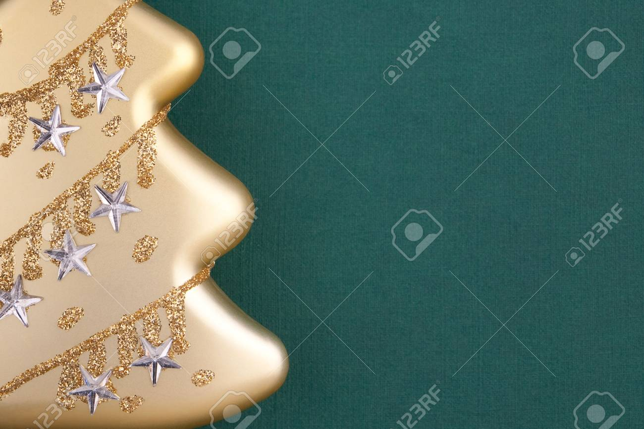 Part of Christmas decoration gold fir on green textured paper background with empty space for your text Stock Photo - 5998471