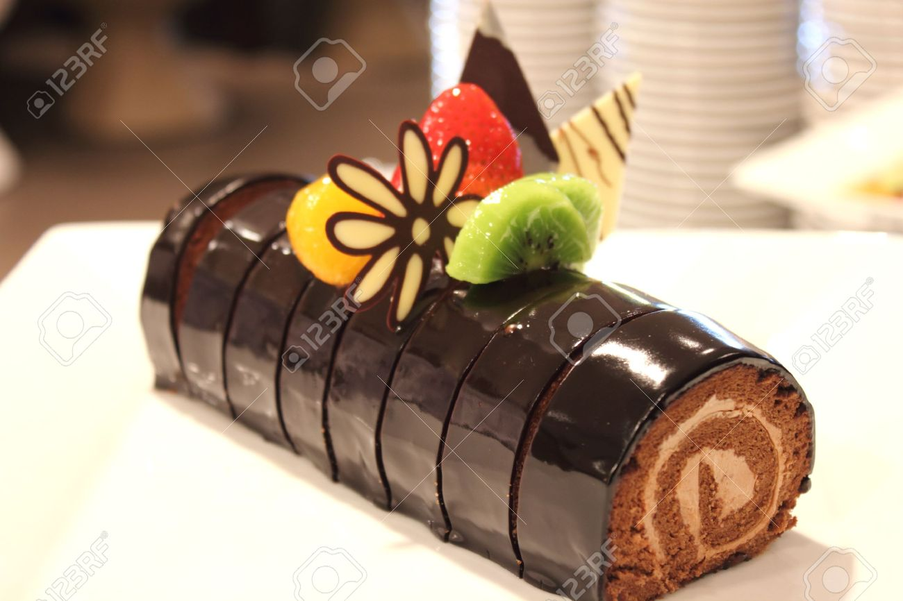 The Chocolate Cake Roll Decoration With Berries Stock Photo ...