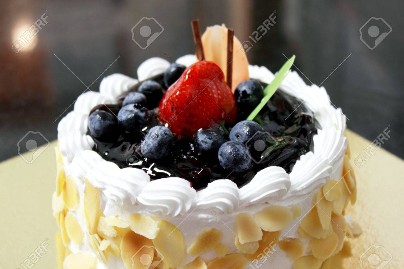 A Blueberry Cheese Cake Decorated With Berries Stock Photo