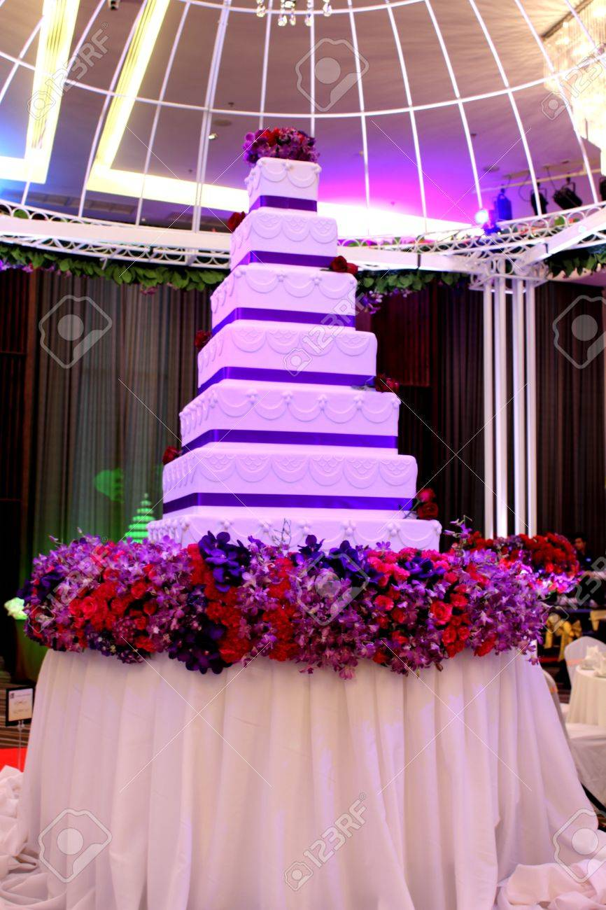 A Tier White And Purple Square Wedding Cake Stock Photo