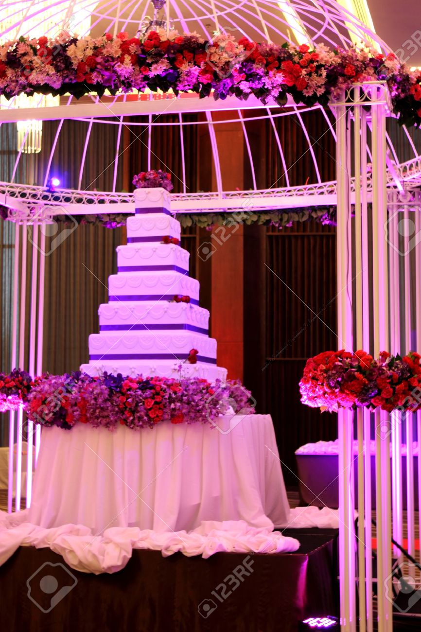 A Tier White And Purple Square Wedding Cake And Dome Stock Photo ...