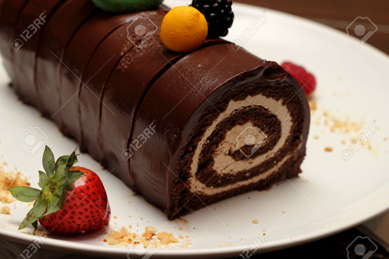 Chocolate Roll Cake With Strawberries On Plate Stock Photo ...