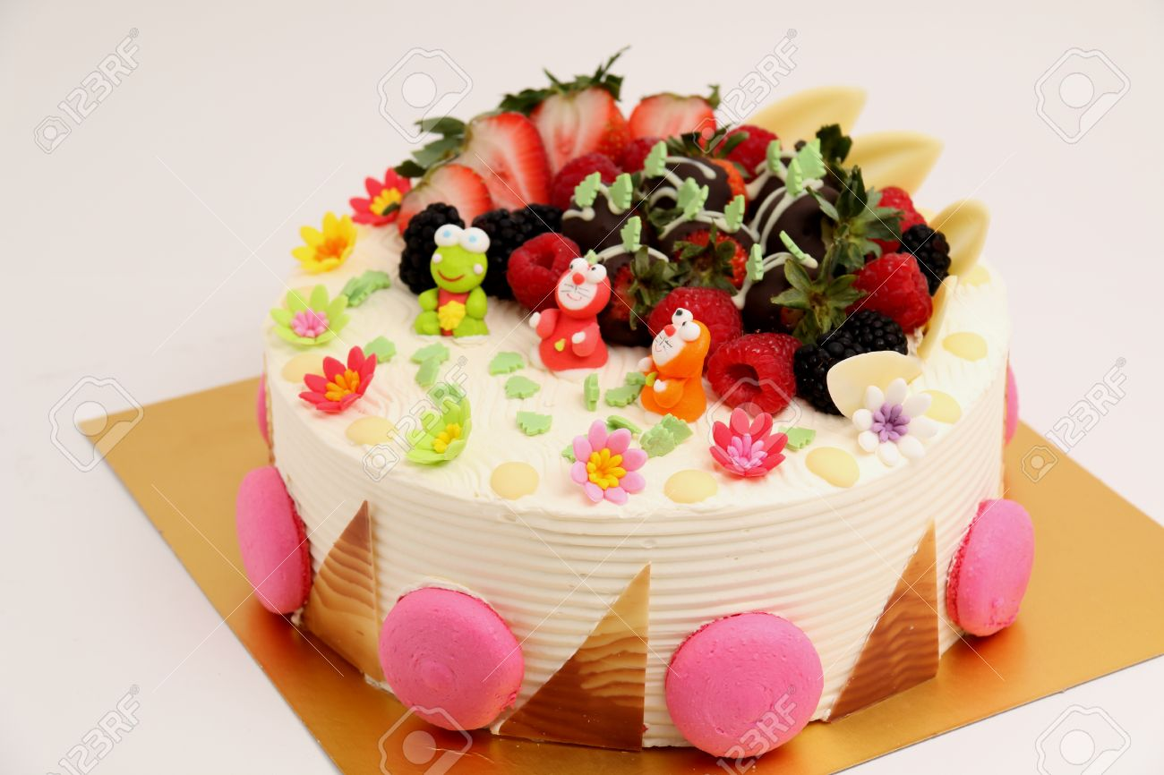 A Round Vanilla Cake Decorated With Fresh Fruits Stock Photo