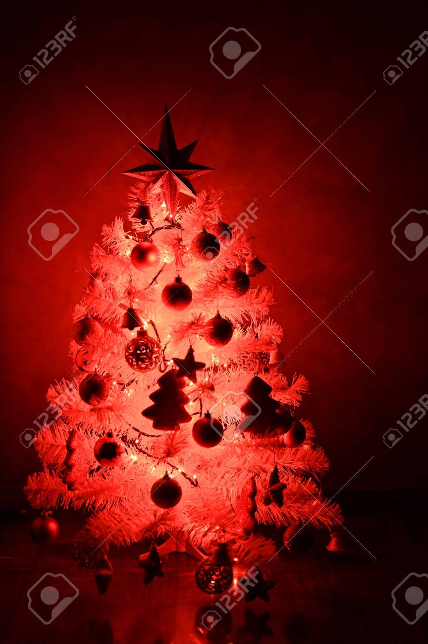 White Christmas Tree With Red Decoration And Christmas Light Stock Photo Picture And Royalty Free Image Image 135557787
