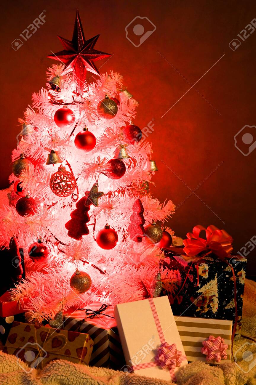White Christmas Tree With Red Decoration And Christmas Light Stock Photo Picture And Royalty Free Image Image 136564242