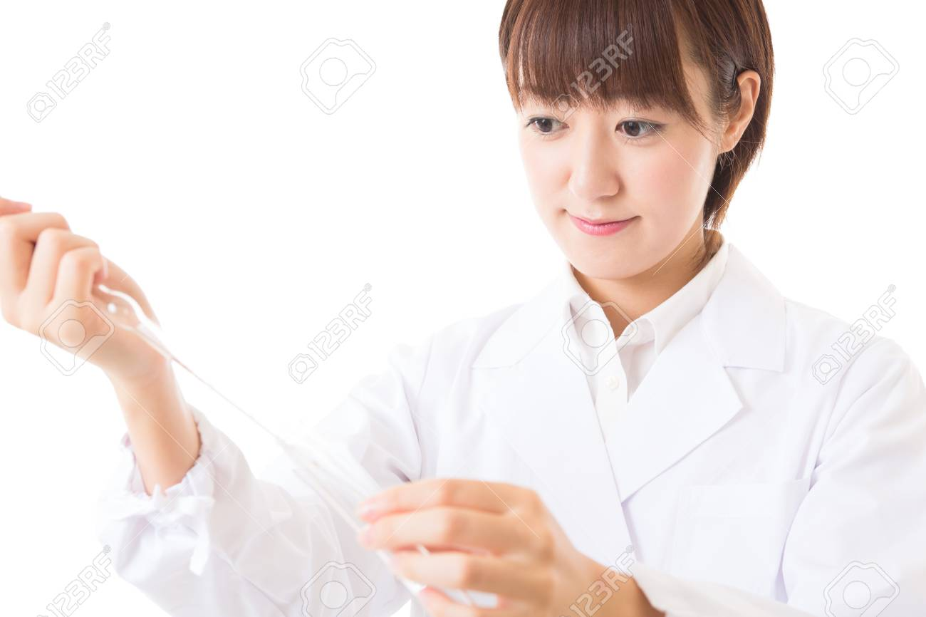 Young woman in a white coat Stock Photo - 16035859