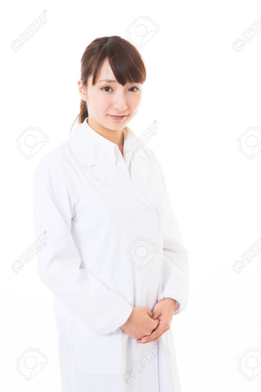 Young woman in a white coat Stock Photo - 16965079