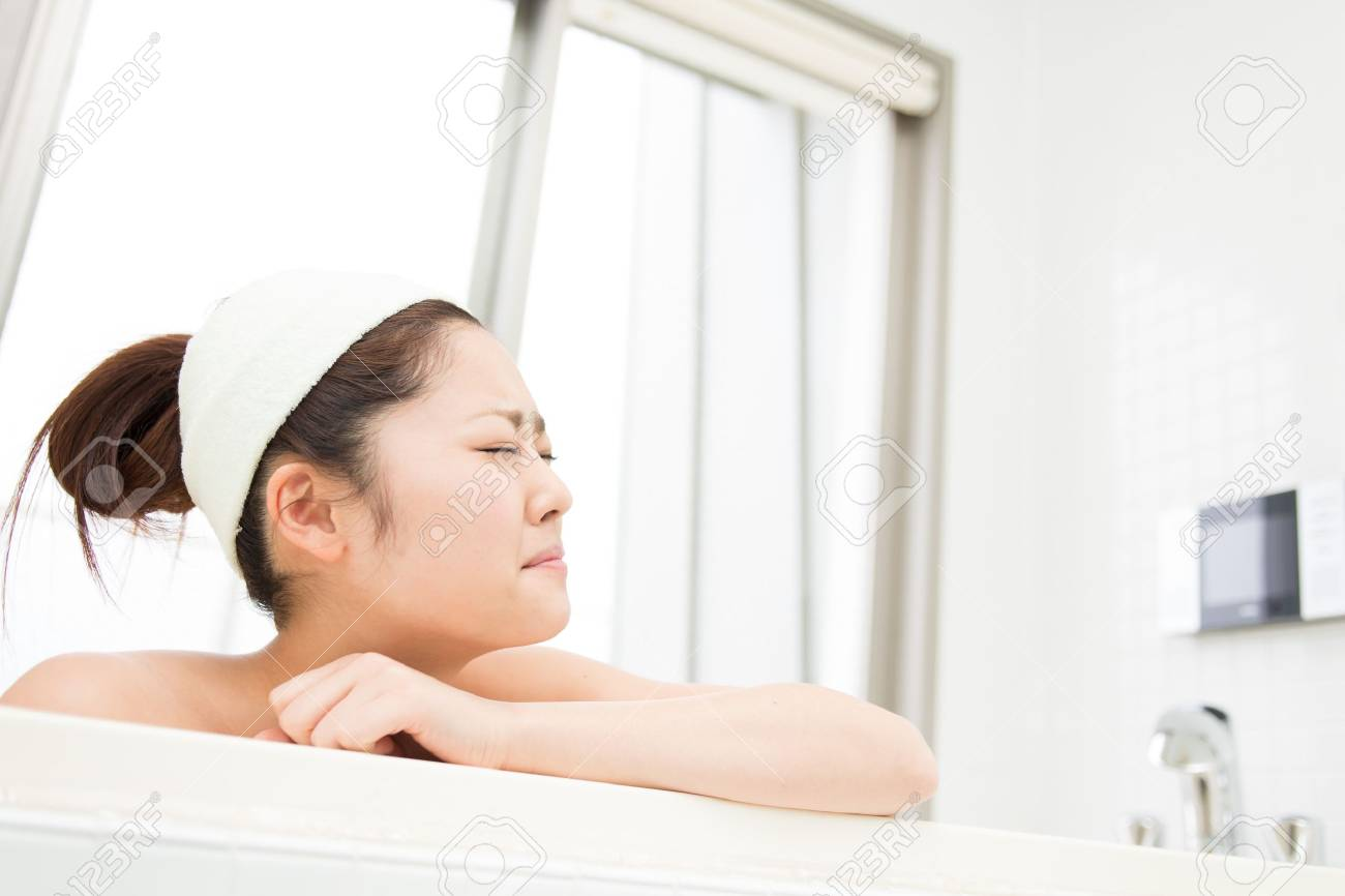 young woman who cries in a bath Stock Photo - 19628529