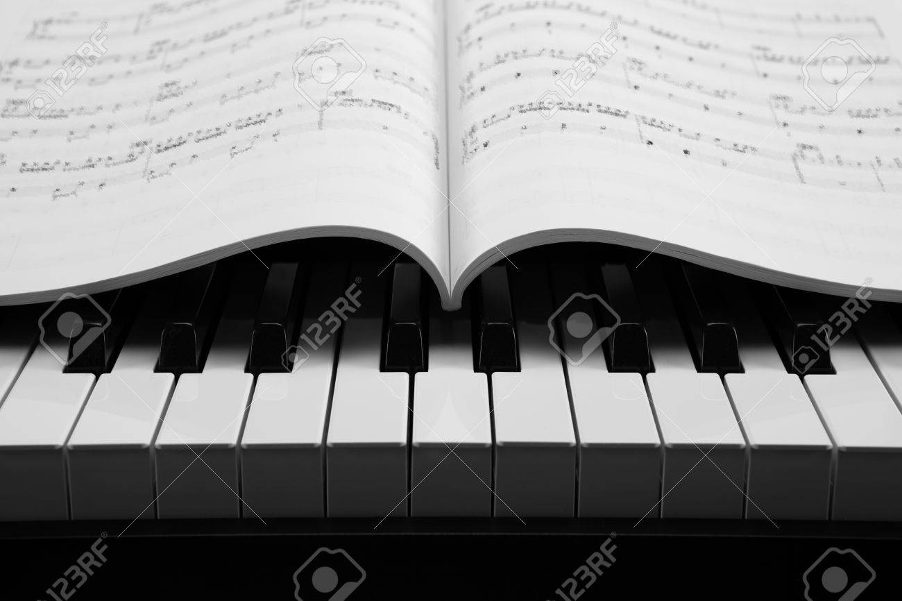 black and white keys of the piano closeup and musical book Stock Photo - 24923418