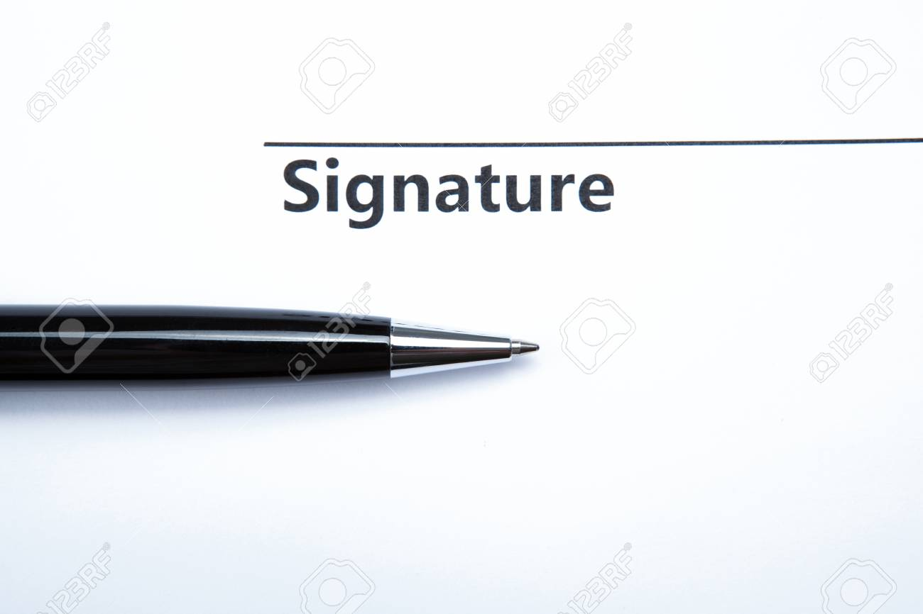 pen and signature on a white closeup Stock Photo - 27997154