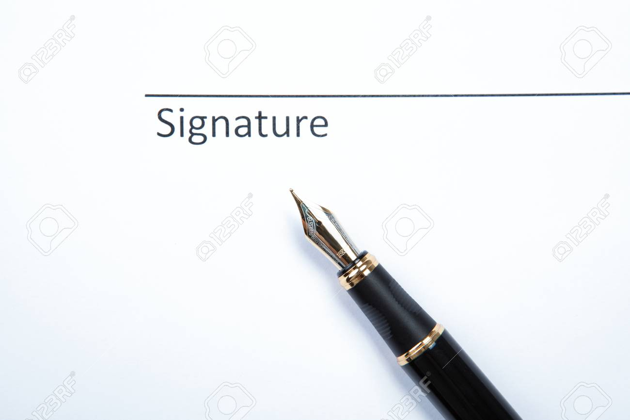 pen and signature on a white closeup Stock Photo - 27997156