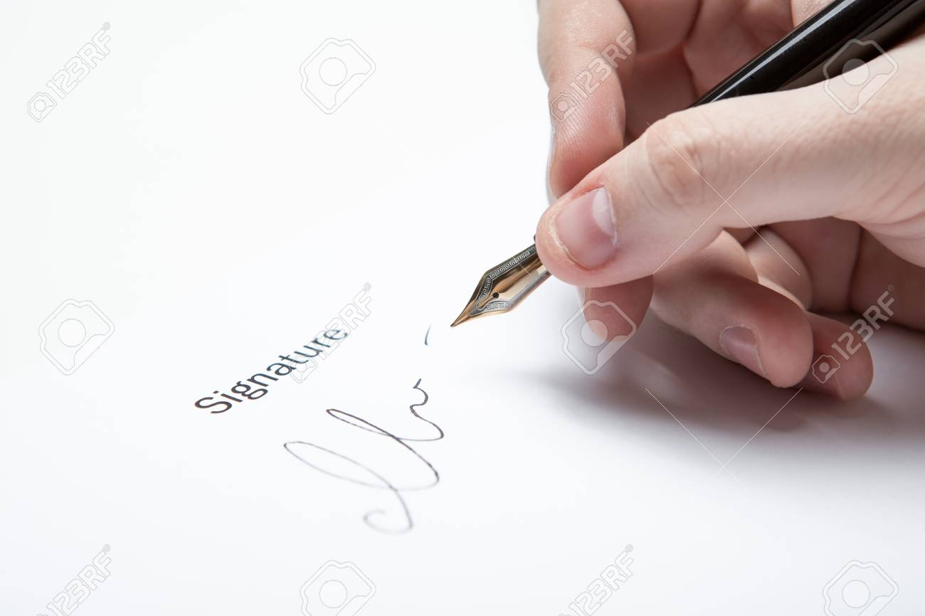 pen in the man's hand and signature on a white closeup Stock Photo - 27997157