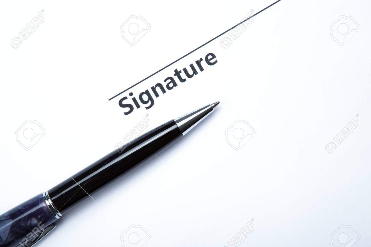 pen and signature on a white closeup Stock Photo - 27997170