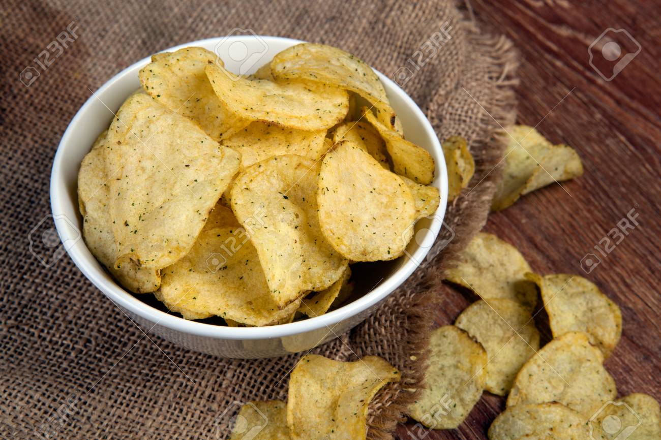 72ffa76bbd still life from a glass bowl with potato chips on a bag Stock Photo -  81604742