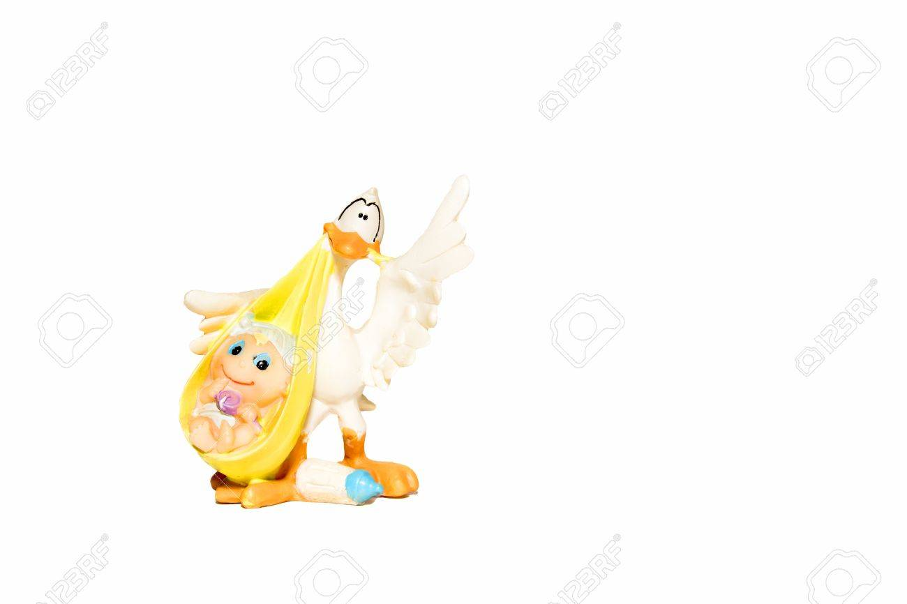 plaster statuette of stork with baby isolated on white background Stock Photo - 16697675
