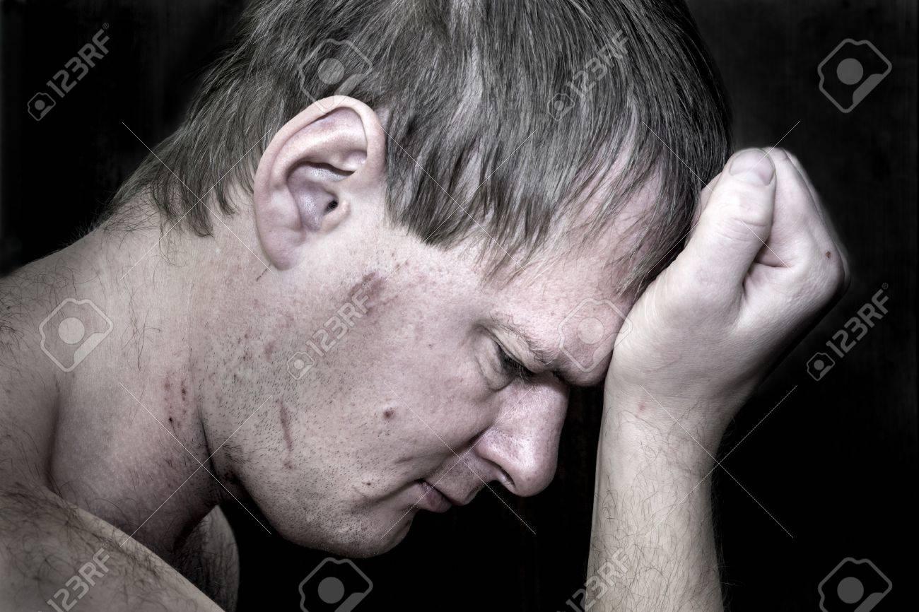 Dark portrait of a man holding his head in despair Stock Photo - 17540222