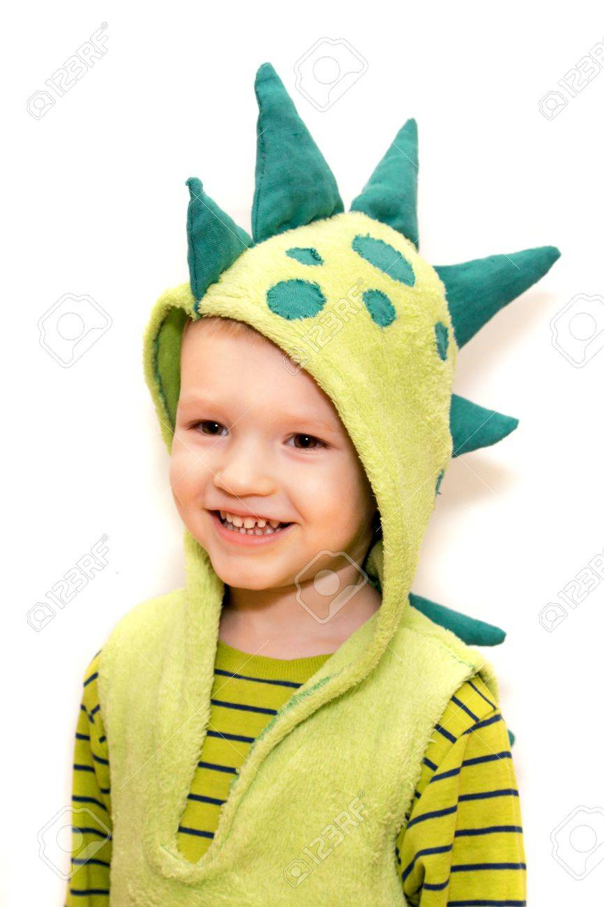 Happy child in a dragon (dinosaur) fancy dress on a white background Stock Photo - 17594628