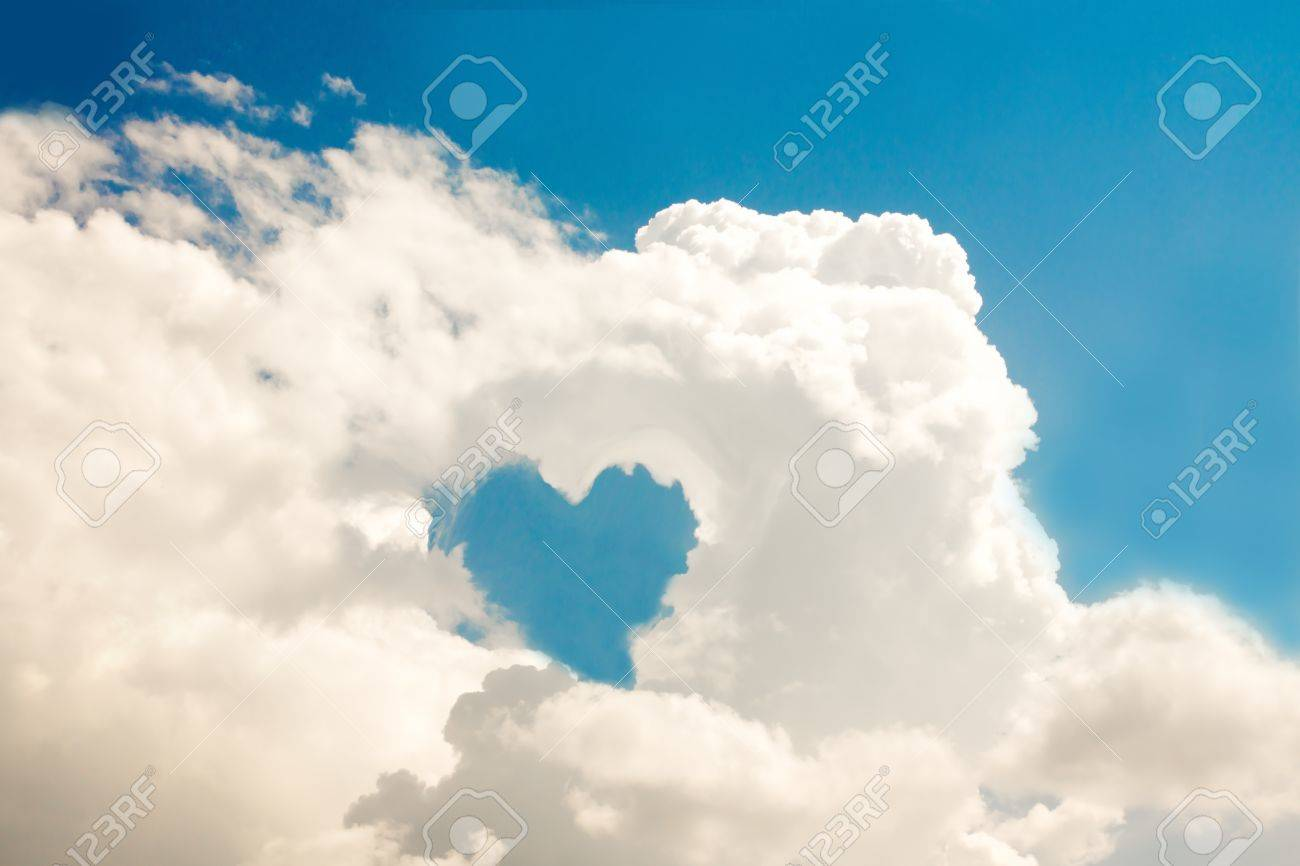 White clouds heart and blue sunny heaven (sky). Stock Photo - 20458151