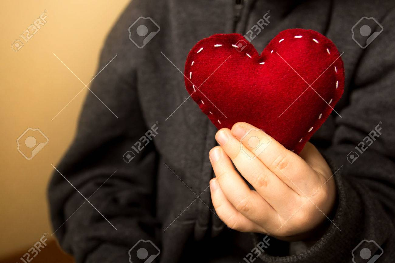 Red heart in child hands, gift, hand made valentine, close up, horizontal - 33237991