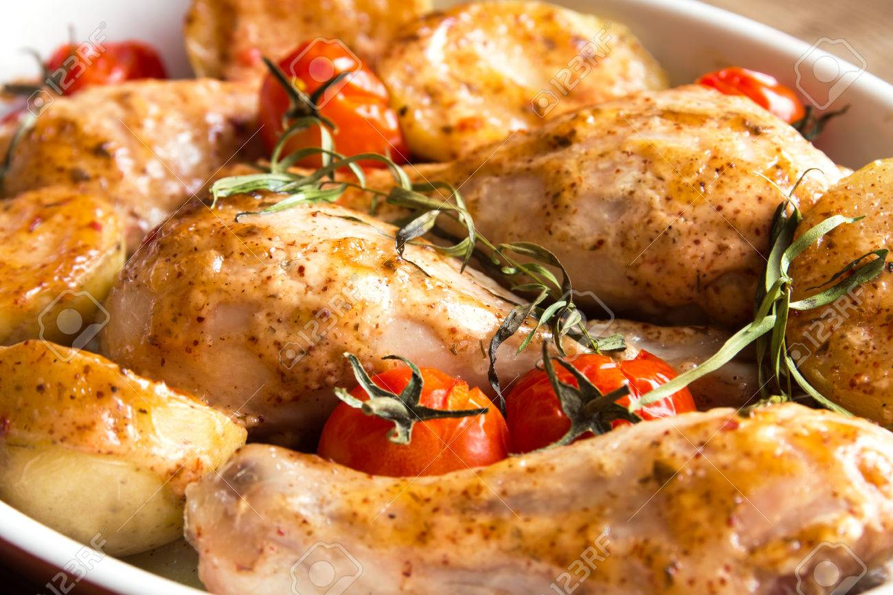 Oven Baked Chicken Legs Wiht Vegetables Tomatoes Potatoes