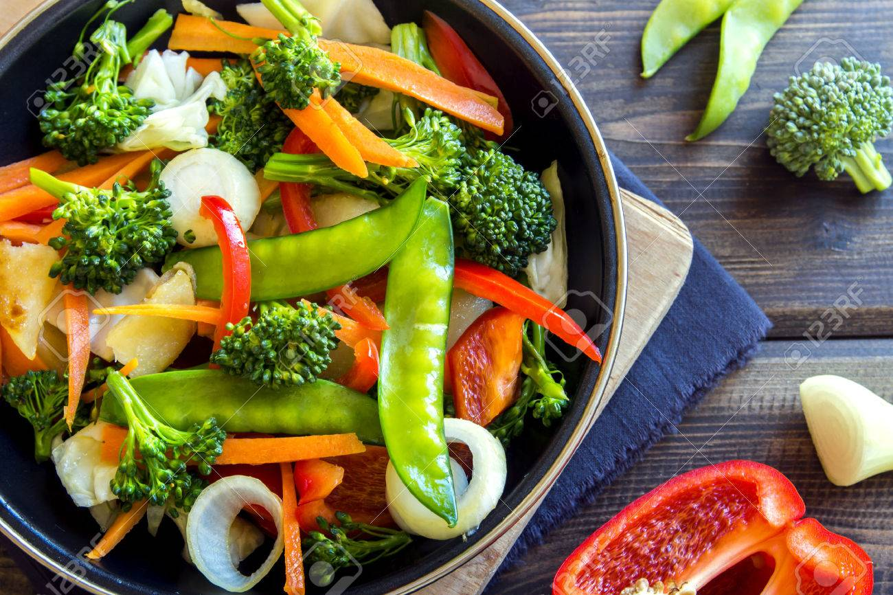 Healthy stir fried vegetables in the pan and ingredients close up - 61120246