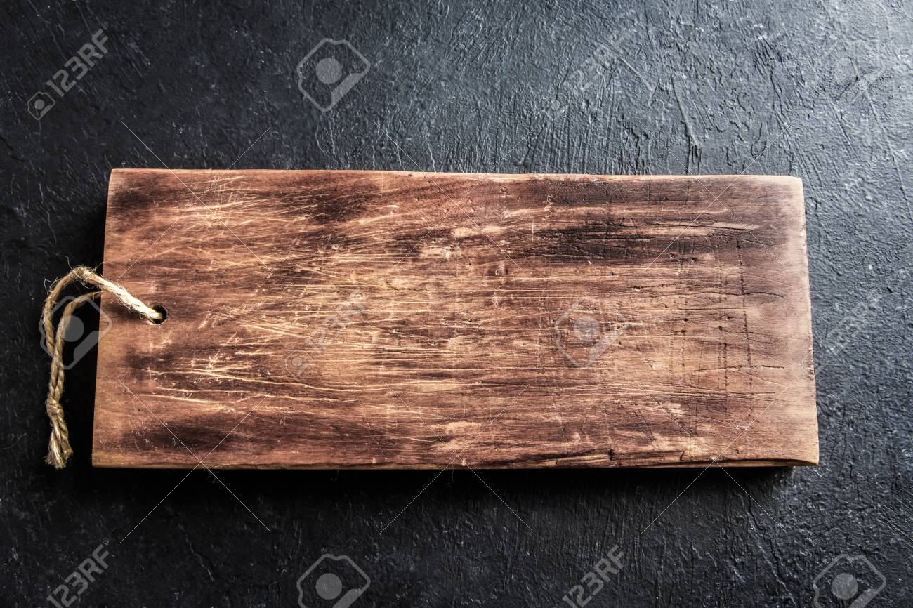 Rustic Wooden Cutting Board On Black Stone Background Close Up Stock Photo Picture And Royalty Free Image Image 94666669