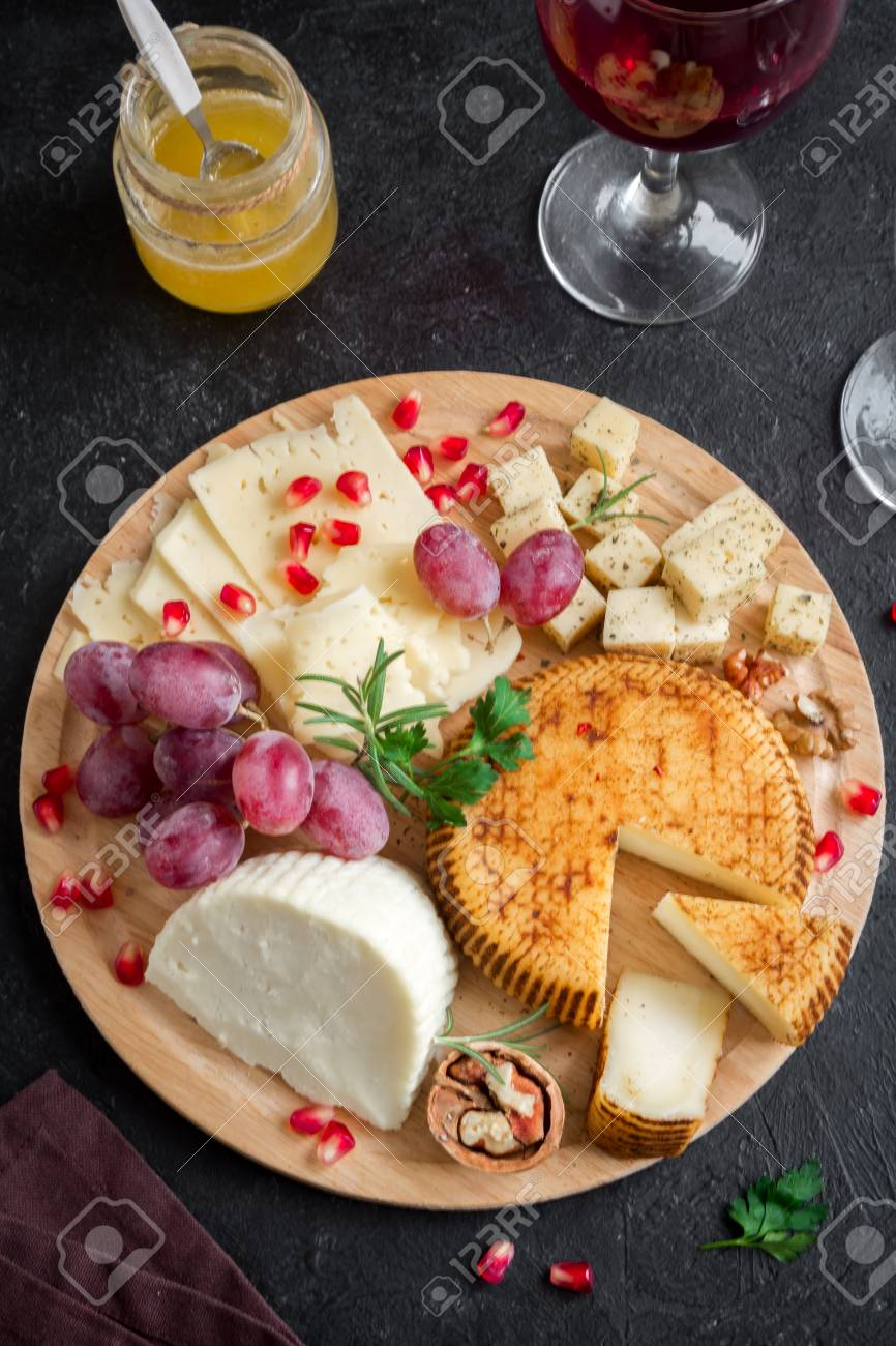 Cheese Platter With Assorted Cheeses Grapes Nuts Over Black Stock Photo Picture And Royalty Free Image Image 98610961